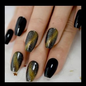 Black and gold catseye nails